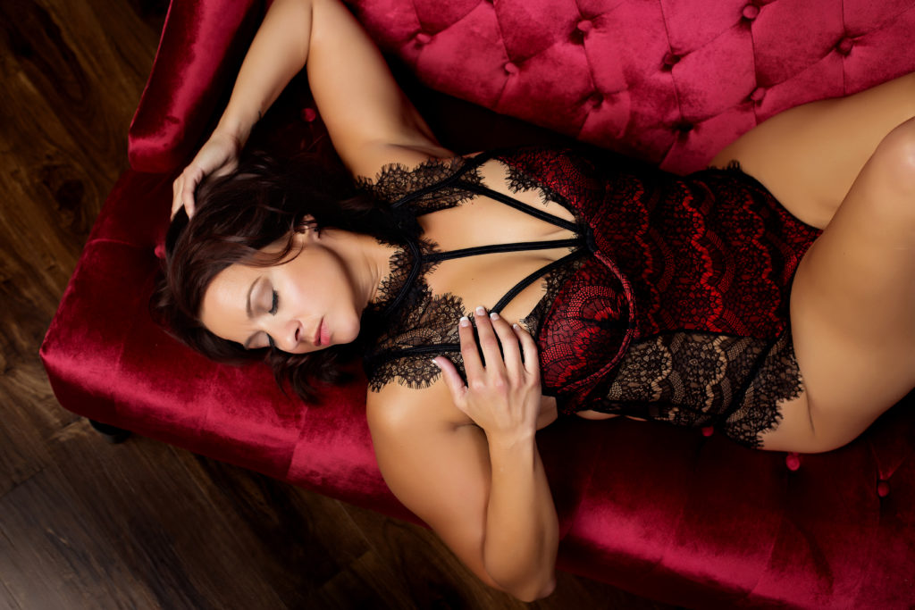 Chicago boudoir photography on a red couch